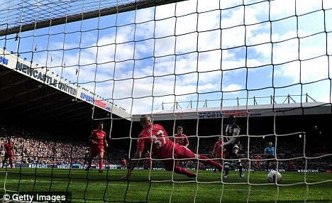 Brace: Papiss Cisse tucks in his second, and offside, goal