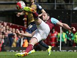 West Ham's Andy Carroll scores his side's second goal during the English Premier League soccer match between West Ham United and Arsenal at Upton Park stadium in London, Saturday April 9, 2016. (AP Photo/Tim Ireland)