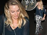 EXCLUSIVE: Margot Robbie seen wearing skeleton slippers and rose print pants at LAX airport in Los Angeles, California.\n\nPictured: Margot Robbie\nRef: SPL1263862  140416   EXCLUSIVE\nPicture by: Diabolik / Splash News\n\nSplash News and Pictures\nLos Angeles: 310-821-2666\nNew York: 212-619-2666\nLondon: 870-934-2666\nphotodesk@splashnews.com\n