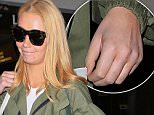 Iggy Azalea without engagement ring at lax friday april 15, 2016 \n/X17online.com
