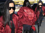 Please contact X17 before any use of these exclusive photos - x17@x17agency.com   Kourtney Kardashian heads out of Los Angeles via an early flight on Saturday morning. The single mother-of-three travels alone but keeps up family allegiances by wearing a jacket promoting brother-in-law Kanye West's Pablo project. Saturday, April 16, 2016 X17online.com PREMIUM EXCLUSIVE