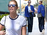 Model Karlie Kloss, wearing high-waisted flared jeans and blue work jacket, walks home after a coffee break in New York City on April 14, 2016.  Pictured: Karlie Kloss Ref: SPL1264374  140416   Picture by: Christopher Peterson/Splash News  Splash News and Pictures Los Angeles: 310-821-2666 New York: 212-619-2666 London: 870-934-2666 photodesk@splashnews.com