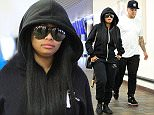 EXCLUSIVE: Blac Chyna and Rob Kardashian at the airport in NYC  Pictured: Blac Chyna and Rob Kardashian Ref: SPL1264625  150416   EXCLUSIVE Picture by: Jackson Lee/Splash News  Splash News and Pictures Los Angeles: 310-821-2666 New York: 212-619-2666 London: 870-934-2666 photodesk@splashnews.com