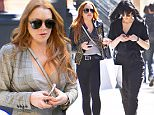 New York, NY - Lindsay Lohan channels Michael Jackson's style in a gold and black leather jacket, black pants, and black and gold loafers while out with her sister Ali Lohan. The two were somewhat matching in mostly black clothing and gold accents as they went shopping at Intermix.\nAKM-GSI       April 15, 2016\nTo License These Photos, Please Contact :\nSteve Ginsburg\n(310) 505-8447\n(323) 423-9397\nsteve@akmgsi.com\nsales@akmgsi.com\nor\nMaria Buda\n(917) 242-1505\nmbuda@akmgsi.com\nginsburgspalyinc@gmail.com