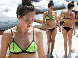 EXCLUSIVE TO INF. April 15, 2016: TOWIE star Megan McKenna shows off her toned body in a neon string bikini while on holiday in Miami, Florida. Mandatory Credit: INFphoto.com Ref: infusmi-11/13
