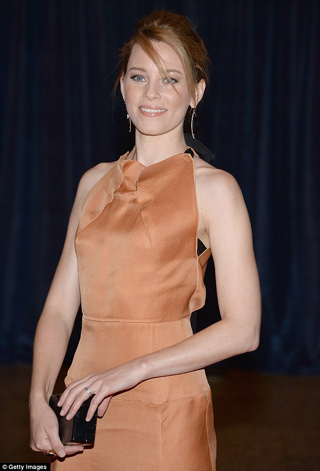 Fit and fabulous: Elizabeth, 39, showed off her toned arms in the halter-neck dress