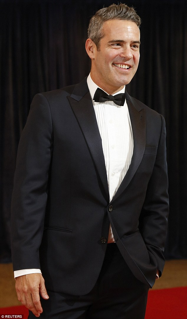 White horse: Television host Andy Cohen showed off his distinguished grey hair as he posed at the event