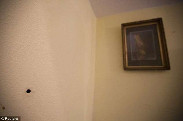 A bullet hole remains on the wall that Kate 'Ma' Barker was shot dead by the FBI