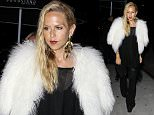 **NO Australia, New Zealand** West Hollywood, CA - Famous stylist Rachel Zoe was spotted with a gal pal for a night at the celeb hotspot, The Nice Guy. Rachel wore a chic all black outfit with a fur coat paired on top.\nAKM-GSI       April 15, 2016\n**NO Australia, New Zealand** \nTo License These Photos, Please Contact :\nSteve Ginsburg\n(310) 505-8447\n(323) 423-9397\nsteve@akmgsi.com\nsales@akmgsi.com\nor\nMaria Buda\n(917) 242-1505\nmbuda@akmgsi.com\nginsburgspalyinc@gmail.com