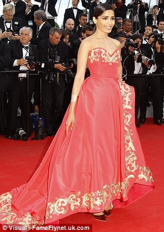 Dramatic: Pinto made sure she stood out on the carpet in her huge strapless gown with oriental trim