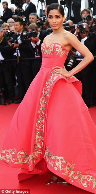 Beauty queen: Freida Pinto showed off her elegant style in this dramatic dress on Sunday
