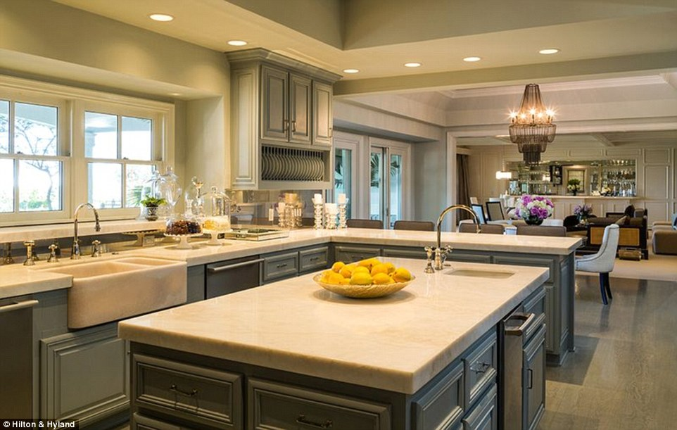 Buttering them up: The exquisite kitchen had a wide island counter and a chandelier which hovered in the dining room