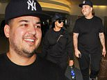 Los Angeles, CA - Newly engaged couple Rob Kardashian and Blac Chyna match their colors as they arrive form a flight at Los Angeles International Airport. Blac Chyna and Rob Kardashian have only been engaged for a minute and there is already talk that a baby is set to come right after the wedding ó if Chyna's mother is to be believed. Tokyo Toni told NW magazine her daughter and soon-to-be son-in-law are planning to get to work on a child right after tying the knot.\n  \nAKM-GSI       April 18, 2016\nTo License These Photos, Please Contact :\nSteve Ginsburg\n(310) 505-8447\n(323) 423-9397\nsteve@akmgsi.com\nsales@akmgsi.com\nor\nMaria Buda\n(917) 242-1505\nmbuda@akmgsi.com\nginsburgspalyinc@gmail.com