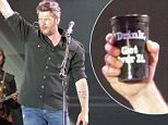 "*EXCLUSIVE* Fort Lauderdale, FL - Blake Shelton boasts ""Drink, Get Over It"" with a cup he is seen drinking out of on stage during his headlining performance at the Tortuga Music Festival.\n \nAKM-GSI     April 17, 2016\nTo License These Photos, Please Contact :\nSteve Ginsburg\n(310) 505-8447\n(323) 423-9397\nsteve@akmgsi.com\nsales@akmgsi.com\nor\nMaria Buda\n(917) 242-1505\nmbuda@akmgsi.com\nginsburgspalyinc@gmail.com"