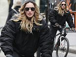 LONDON, ENGLAND - APRIL 18:  Madonna seen cycling in Mayfair on April 18, 2016 in London, England.  (Photo by Neil Mockford/GC Images)