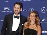 Jamie Redknapp, left, and his wife Louise Redknapp, right, pose for photos as they arrive for the Laureus World Sports Awards in Berlin, Germany, Monday, April 18, 2016. (AP Photo/Markus Schreiber)