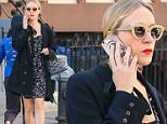 Picture Shows: Chloe Sevginy  April 17, 2016\n \n 'American Horror Story: Hotel' actress Chloe Sevigny was spotted out and about in New York City, New York. \n \n Chloe looked stylish in a black coat, obscuring a patterned mini-dress.\n \n Exclusive - All Round \n UK RIGHTS ONLY\n \n Pictures by : FameFlynet UK © 2016\n Tel : +44 (0)20 3551 5049\n Email : info@fameflynet.uk.com