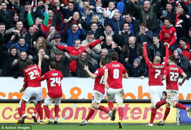 Delight: McGugan sends the Forest fans into ecstatics at the KC Stadium with his late winner to move Billy Davies side into 6th place