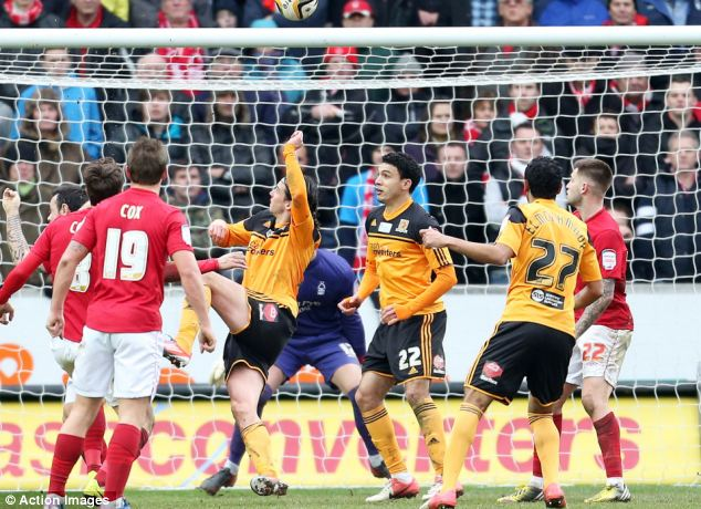 Excellent vision: George Boyd (third left) scores the opening goal