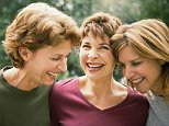 Friends laughing and smiling together --- Image by © Laura Doss/Corbis