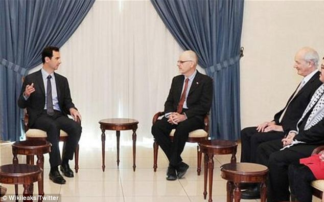 Poor judgement? Syrian President Bashar Assad with John Shipton, the father of whistleblowing activist Julian Assange, during the visit to the war-torn country by a delegation from Australia's Wikileaks Party