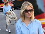 April 19, 2016: Sienna Miller casual in a pale blue button up shirt, jeans, and sneakers is spotted chatting with a friend in New York City.\nMandatory Credit: Dara Kushner/INFphoto.com      Ref.: infusny-05/42