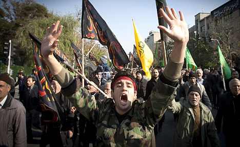 Tensions: Demonstrators shout slogans during a protest in Tehran which lead to the British Embassy being ransacked