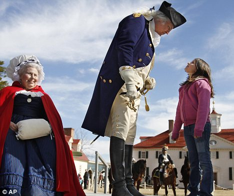 Play acting: Dean Malissa as General George Washington meets visitors at Mount Vernon, Washington's historic home in Virginia as the nation celebrates the President's Day weekend