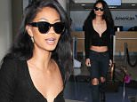 Victoria's Secret model, Chanel Iman is seen showing off her toned body as she catches a flight out of Los Angeles.   The American supermodel was seen wearing a low cut crop-top, low-riding jeans and boots.\n\nPictured: Chanel Iman\nRef: SPL1267286  190416  \nPicture by: Splash\n\nSplash News and Pictures\nLos Angeles: 310-821-2666\nNew York: 212-619-2666\nLondon: 870-934-2666\nphotodesk@splashnews.com\n