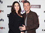"""LOS ANGELES, CALIFORNIA - APRIL 01:  Singer Nick Carter (R) and wife Lauren Kitt attend the premiere of Syfy's """"Dead 7"""" at Harmony Gold on April 1, 2016 in Los Angeles, California.  (Photo by David Livingston/Getty Images)"""