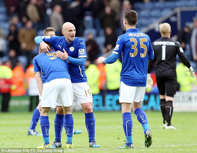 Cambiasso, Jamie Vardy (left) and David Nugent (right) look relieved after their narrow home win