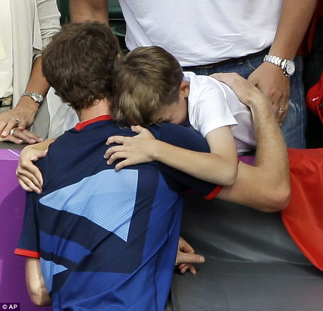 Happy to oblige: The tennis star can't resist the youngster's demand and holds him in celebration