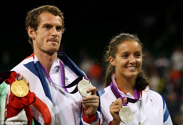 Medals at the double: Murray shows off his gold medal and the silver he won with partner Laura Robson