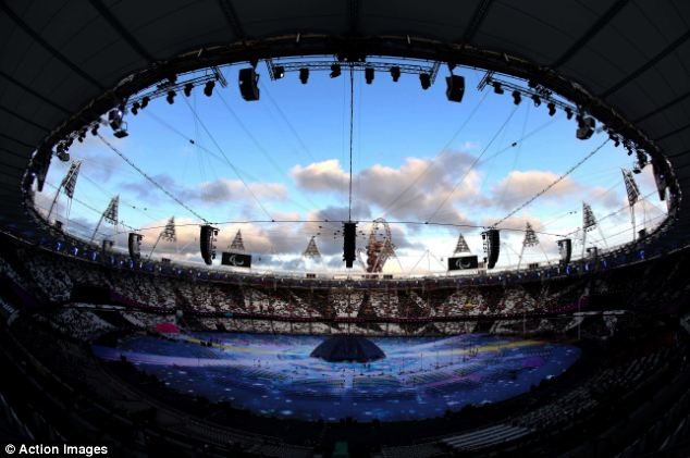 First view: Spectators pour into the Olympic Stadium today ahead of the Paralympic Opening Ceremony