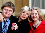 File photo dated 30/10/08 of Victoria Wood with children Henry and Grace Durham after receiving her CBE at Buckingham Palace, London, as Wood has died aged 62 after a short battle with cancer, her publicist has said. PRESS ASSOCIATION Photo. Issue date: Wednesday April 20, 2016. See PA story DEATH Wood. Photo credit should read: Steve Parsons/PA Wire