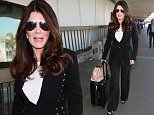 Los Angeles, CA - Lisa Vanderpump looked ready for a meeting as she was seen hopping onto a flight at LAX. Ken Todd and the Pump restauranteur were both dressed sharp for their flight out of the city.\nAKM-GSI     April 20, 2016\nTo License These Photos, Please Contact :\nSteve Ginsburg\n(310) 505-8447\n(323) 423-9397\nsteve@akmgsi.com\nsales@akmgsi.com\nor\nMaria Buda\n(917) 242-1505\nmbuda@akmgsi.com\nginsburgspalyinc@gmail.com