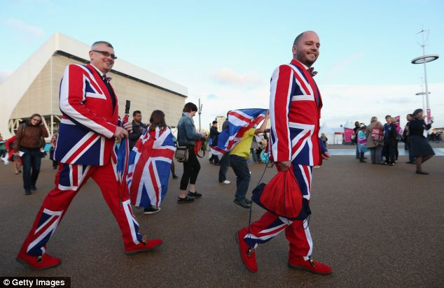 Patriotic: This pair of excited spectators are kitted out in Great Britain suits on their way to the ceremony