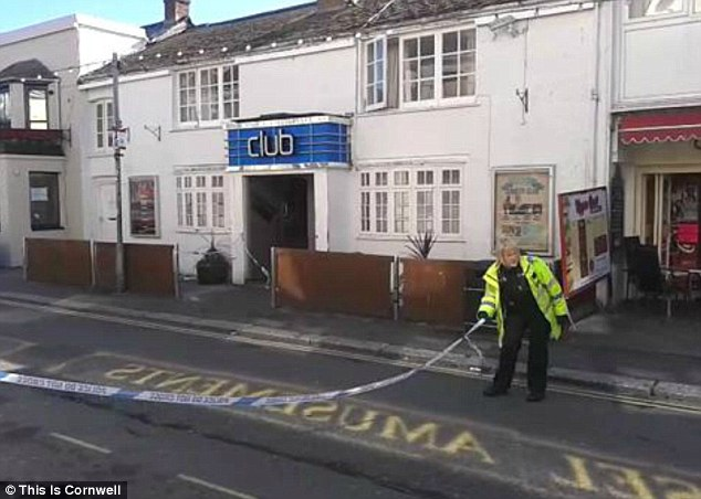Death scene: The Sailors nightclub in Newquay is cordoned off by police early today after a man died in what officers say was a 'tragic accident'