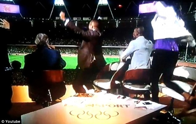 Joy: The commentators cannot stay in their seats as Farah races home to victory