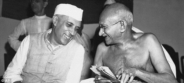 Jawaharlal Nehru, pictured with Mohandas Gandhi, the Mahatma (right) in 1946, strengthened India's democratic roots, abolished zamindari, attacked the caste system and blunted the forces of communalism