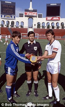 England captain Bryan Robson (right) meets USA captain Rick Davis, watched by referee Edgardo Codesal Mendez before the International friendly match at the Memorial Coliseum Stadium in Los Angeles, 16th June 1985. England won 5-0