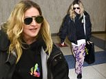 **NO NEW YORK PAPERS** *EXCLUSIVE* New York, NY - After repairing her mother-son relationship with Rocco, Madonna is now back in US soil. The Queen of pop arrived tonight at JFK Airport with her entourage, she even shared a shy smile with our photog.\nAKM-GSI      April 20, 2016\n**NO NEW YORK PAPERS**\nTo License These Photos, Please Contact :\nSteve Ginsburg\n(310) 505-8447\n(323) 423-9397\nsteve@akmgsi.com\nsales@akmgsi.com\nor\nMaria Buda\n(917) 242-1505\nmbuda@akmgsi.com\nginsburgspalyinc@gmail.com