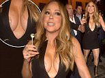 Mariah Carey is licking a lollipop while arriving at the VIP Room in Paris, France, on April 21st 2016. She is victim of a wardrobe malfunction! 22 April 2016. Please byline: Vantagenews.com