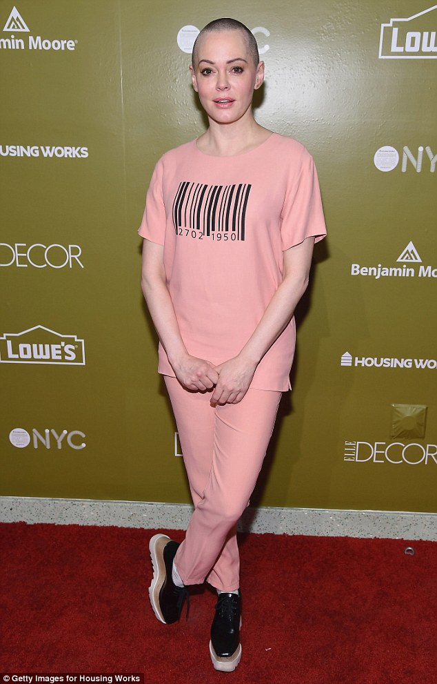 Fashion-forward: Rose McGowan wore a pink ensemble emblazoned with a black barcode as she attended Housing Work's Design On A Dime Opening Night Reception in New York City on Thursday
