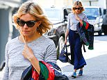 New York, NY - Stylish Sienna Miller is spotted out in Soho rocking shades of blue. She's seen in light blue mule chunky heel paired with navy wide leg cropped pants. \n  \nAKM-GSI        April 21, 2016\nTo License These Photos, Please Contact :\nSteve Ginsburg\n(310) 505-8447\n(323) 423-9397\nsteve@akmgsi.com\nsales@akmgsi.com\nor\nMaria Buda\n(917) 242-1505\nmbuda@akmgsi.com\nginsburgspalyinc@gmail.com