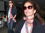 Los Angeles, CA - Cindy Crawford was spotted arriving at LAX. The supermodel had her hands full with luggage for a second until someone aided her. She looked casual but chic in a pair of blue jeans, white top, navy blazer, and scarf for style. \nAKM-GSI     April 21, 2016\nTo License These Photos, Please Contact :\nSteve Ginsburg\n(310) 505-8447\n(323) 423-9397\nsteve@akmgsi.com\nsales@akmgsi.com\nor\nMaria Buda\n(917) 242-1505\nmbuda@akmgsi.com\nginsburgspalyinc@gmail.com