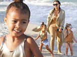 Exclusive... 52031858 'Keeping Up With The Kardashians' sisters Kim Kardashian and Kourtney Kardashian head to the beach with their two daughters in Miami, Florida on April 22, 2016. .  Penelope Disick's sunglasses matched her mom.  North appeared to enjoy most of her time, but got a little unhappy and needed to hug her mom for comfort.  The group walked by the shoreline, and had a great time with each other. ***NO WEB USE W/O PRIOR AGREEMENT - CALL FOR PRICING*** FameFlynet, Inc - Beverly Hills, CA, USA - +1 (310) 505-9876