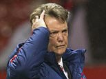 Manchester United's manager Louis van Gaal makes his way from the pitch after his team's 2-1 win in the English Premier League soccer match between Manchester United and Swansea City at Old Trafford Stadium, Manchester, England, Saturday. (AP Photo/Jon Super)