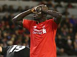 LIVERPOOL, ENGLAND - JANUARY 26:  Mamadou Sakho of Liverpool (17) reacts after a missed chance during the Capital One Cup semi final second leg match between Liverpool and Stoke City at Anfield on January 26, 2016 in Liverpool, England.  (Photo by Clive Brunskill/Getty Images)