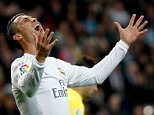 epaselect epa05269550 Real Madrid's Cristiano Ronaldo reacts during the Spanish Liga Primera Division soccer match played at the Santiago Bernabeu stadium, in Madrid, Spain, 20 April 2016.  EPA/JuanJo Martin